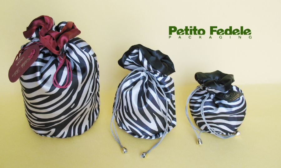 Soft pouch with round base internal lining in satin and external in zebra like fabric