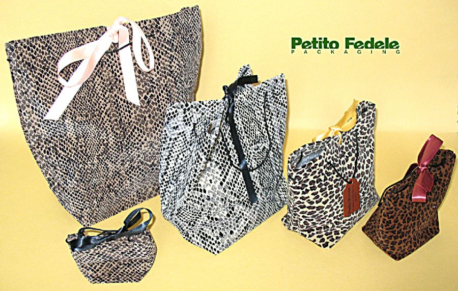 Soft pouch shopping bag style in leopard like fabric