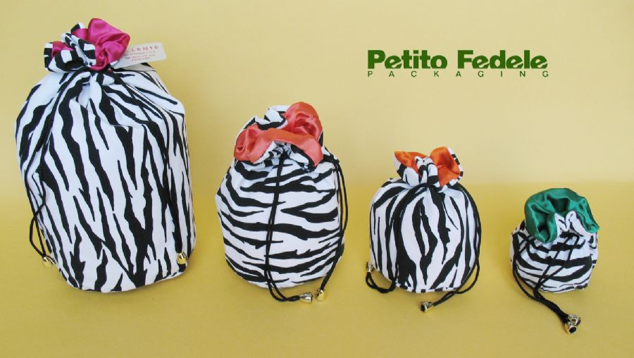 Soft pouch with round base internal lining in satin and external in flock zebra like fabric